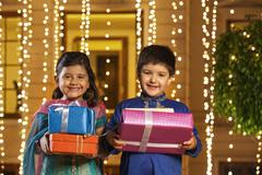 Portrait of children with gifts Stock Photos