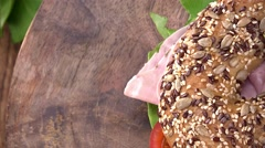 Portion of Bagel with Ham (not loopable; 4K) Stock Footage