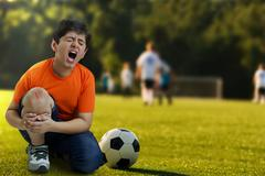 Boy crying out in pain Stock Photos