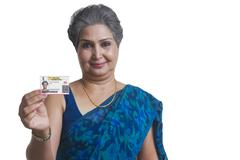Old woman with identity card Stock Photos