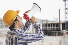 Building Contractor shouting through megaphone Kuvituskuvat