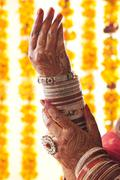 Brides hands in wedding bangles and ring Stock Photos