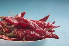 Close-up of a bowl of dried chili Stock Photos