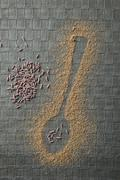 Shape of a spoon in randomly scattered cumin powder Stock Photos