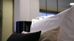 modern bedroom with black and white pillows and black lamp at home - stock footage