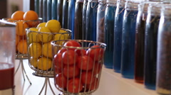Interior design with colorful decorative glass bottles and fruits on tabletop - stock footage