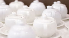 White teapots on a table Stock Footage