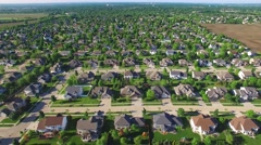 Aerial flyover of beautiful upper class neighborhood on sunny morning - stock footage