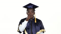 Graduate makes hand gestures. White. Close up Stock Footage