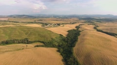 Italy, Tuscany, aerial, typical landscape with hills, wheat fields, farmstead. - stock footage