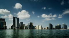 Timelapse of the clouds floating above the downtown buildings, Sharjah, UAE Stock Footage