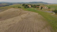 Italy, Tuscany, aerial, typical landscape with hills, wheat fields, farmstead. Stock Footage