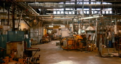 Empty factory floor that has seen heavy use over the years Stock Footage