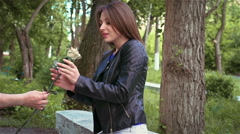 Stranger gives single woman a metal rose in the Park Stock Footage