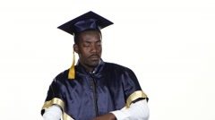 Graduate in the graduation form expresses refusal. White. Close up Stock Footage