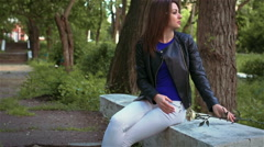 The stranger quietly gives metal rose for lonely girl on the bench Stock Footage