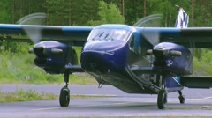 Blue plane for skydivers prepare to take off in air in green woods. Rotate Stock Footage