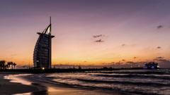 Timelapse of the twilight at the Burj Al Arab and the Jumeirah beach in Dubai Stock Footage