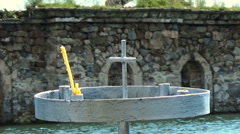 Old christian church under water with metal candlestick on the shore and cross Stock Footage