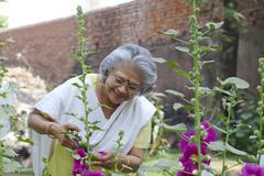 Senior woman tending her garden Stock Photos