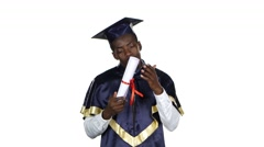 Student kissing diploma. White Stock Footage