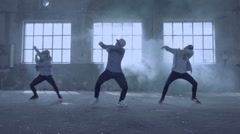 Young group dancing in an abandoned building with smoke. Arkistovideo