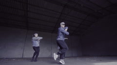 Group dancing choreography in an abandoned building in slow motion. Stock Footage