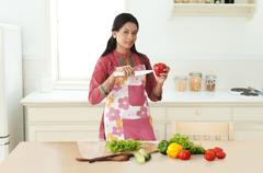 Woman holding capsicum and knife Stock Photos