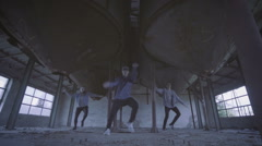 Young group dancing choreography in an abandoned building. Stock Footage