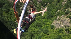 Klisura Bridge, Bulgaria - June 11, 2016: Bungee jumpers 230 feet bridge jump Stock Footage