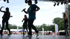 Aerobics zumba sports people dancing before the crowd at festival healthy life Stock Footage