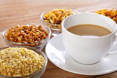 Close-up of fried snacks in bowls with cup of tea Stock Photos