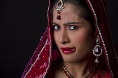 Beautiful Indian bride in traditional wedding dress Stock Photos