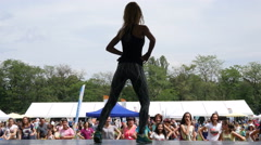 Aerobics zumba sports girl dancing before the crowd at festival a healthy life Stock Footage