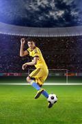Football player with ball on field of stadium Kuvituskuvat