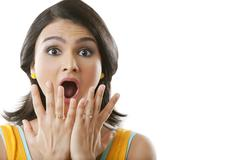 Portrait of shocked hispanic woman with mouth open Stock Photos
