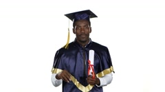 Graduate with a diploma and the academic hat. White Stock Footage