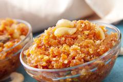 Gajar ka halwa in a bowl , indian sweets Stock Photos