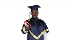 Man with graduation gown and diplom. White Stock Footage