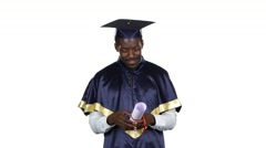 Graduate looks into the diploma. White Stock Footage