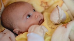 Happy newborn baby yawns closeup - stock footage