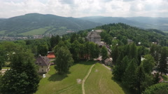 Aerial View. Panorama. Flight over a green grassy in mountains. Stock Footage