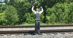 Young Business Man Smiling with Joy in Victory Success by Train, 4K Stock Footage