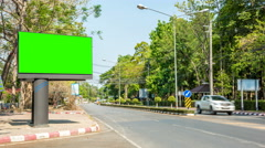 Billboard in the city near road - green screen Stock Footage