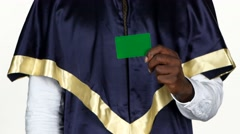 Graduate holds a green card. White. Close up Stock Footage