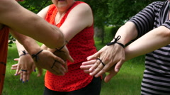 Clap hands - Bulgarian folk hobby skill Chetkalina - knocking out rhythm - stock footage