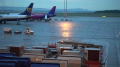 Airport tug transporting cargo at Budapest Airport Stock Footage