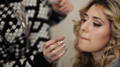 Makeup artist makes a girl beautiful makeup before an important event - stock footage
