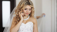 Happy bride talking on the phone Stock Footage