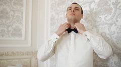 A man in a white shirt dresses black tie. Stock Footage